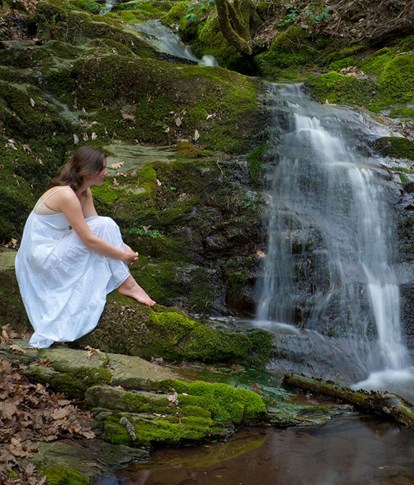 Woman at waterfall